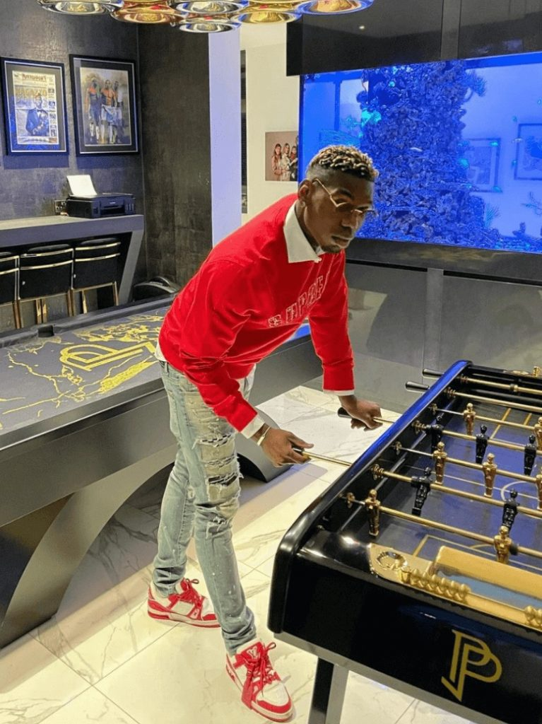 paul-pogba-dressed-in-red-lv-trainer-shoes-that-havent-come-out-yet