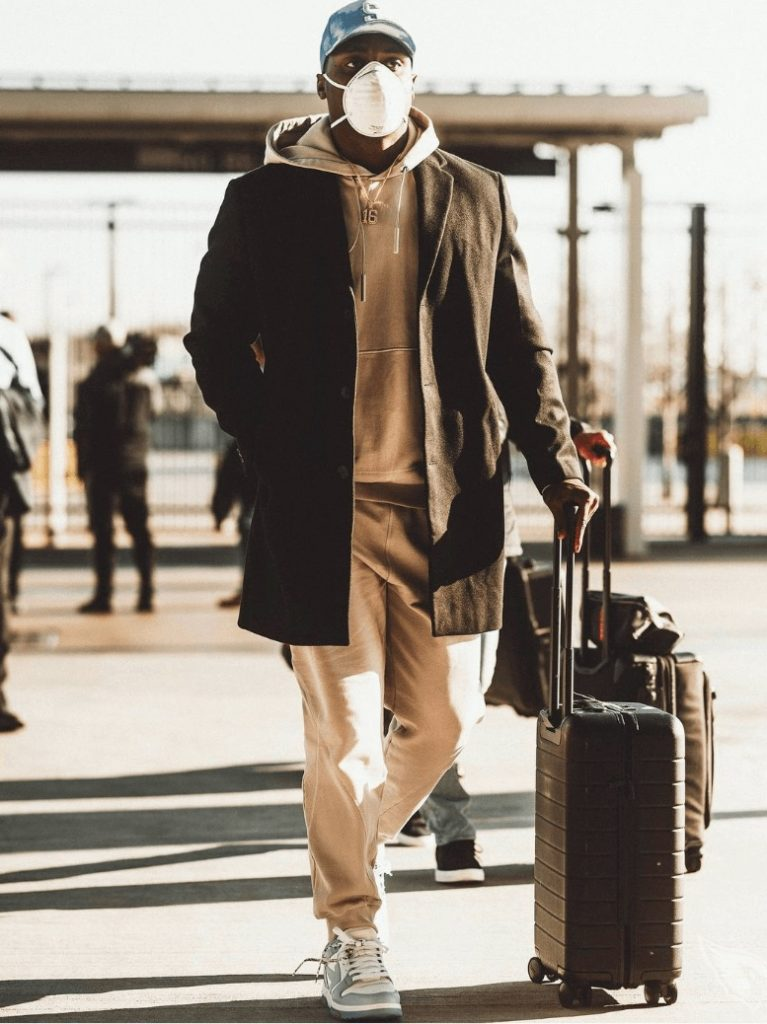trent-sherfield-walking-with-his-suitcase-and-asos-jacket