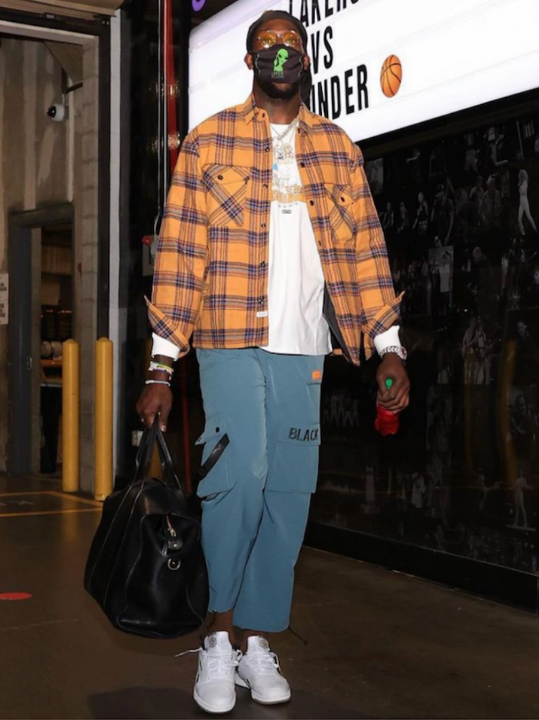 montrezl-harrell-arriving-in-a-blue-and-orange-flannel-shirt